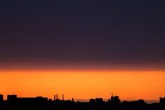 Orange Sonnenuntergangstadtbild Auf lagerbild Stockfotografie