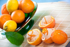 Orange Sorbet in Hollowed Fruits. Three hallowed oranges filled with fresh italian orange sorbet on a japanese towel Royalty Free Stock Photography