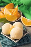 Orange sorbet. Homemade orange sorbet in a bowl stock image