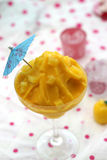 Orange sorbet sherbet arranged in glass. With colorful background Royalty Free Stock Photo