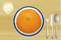 An orange soup on a plate. Illustration of an orange soup on a plate on a wooden background Stock Photos