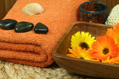 Orange spa accessories. Colorful orange wellness and spa therapy with beautiful marigold flowers Stock Photos