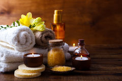 Orange Spa setting. And health care items on dark wooden background. Space for text Stock Photo