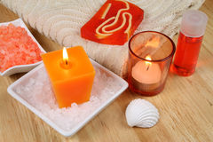 Orange Spa still life. Orange Spa resort therapy composition. Candle, oil and salt crystals Royalty Free Stock Photo