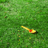 Orange spade in a green field Stock Image