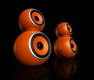 Orange speaker balls. Three dimensional orange speaker spheres isolated on black Stock Photo