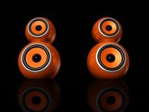 Orange speaker balls. Three dimensional orange speaker spheres isolated on black Royalty Free Stock Photos