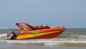 Orange speedboat Stock Images