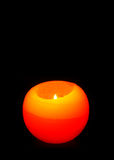 Orange Sphere candle isolated on black Royalty Free Stock Images