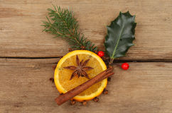 Orange and spice with holly Royalty Free Stock Photo