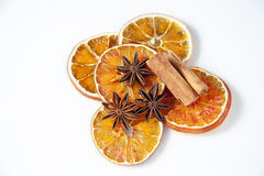 Orange and spices on white background royalty free stock photos