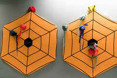 Orange spider darts board on the wall for a kid Stock Image