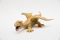 Orange Spielzeugdrache lizenzfreies stockfoto