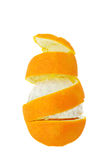 Orange spiral. Partially peeled orange isolated on white. Peel rises up spiral Royalty Free Stock Image