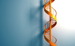 Orange spiral staircase on the blue wall Royalty Free Stock Image