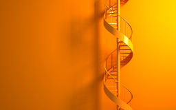 Orange spiral staircase on the orange wall Stock Images