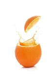 Orange with splash Stock Photography