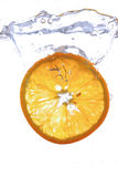 Orange splash. Photography of an orange slice splashing in water Royalty Free Stock Image