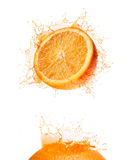 Orange splash drink Stock Photography