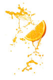 Orange splash. Orange juice splashing with orange slice isolated on white Stock Photos