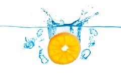 Orange Splash in water. Slice of orange splashing in water stock photography