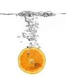 Orange splash in water Stock Photography