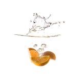 Orange splash on water, isolated Royalty Free Stock Photo