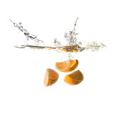 Orange splash on water, isolated Royalty Free Stock Photography
