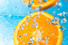 Orange splash in water, top view Royalty Free Stock Image