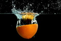 Free Orange Splashing Into Water Stock Photography - 23035652