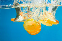 Orange SPLASHING IN WATER Royalty Free Stock Photos