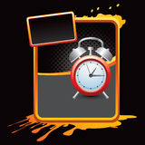 Orange splattered ad with alarm clock Royalty Free Stock Images