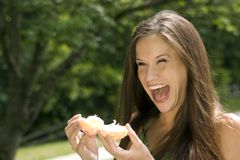 Excited Female Spliting Open Fresh Orange Fruit Royalty Free Stock Image