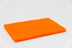 Orange spola ren block med vit bakgrund och den selektiva fokusen Arkivbilder