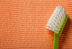 Orange sponge background and brush Stock Photo
