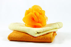 Orange sponge and two towels Stock Images