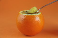Orange with a spoon Royalty Free Stock Photography