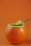 Orange with a spoon Royalty Free Stock Photo