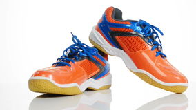 Orange sport badminton shoes rotating over white background stock video footage