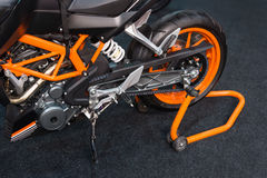 Orange sport bike on exibition stand. Cropped image. Stock Photography