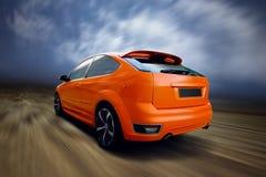 Orange sport car. Beautiful orange sport car on road Royalty Free Stock Photography