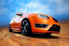 Orange sport car. Beautiful orange sport car on road Royalty Free Stock Photography