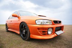 Orange sport car Royalty Free Stock Images