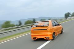 Orange sport car drive fast Royalty Free Stock Photo