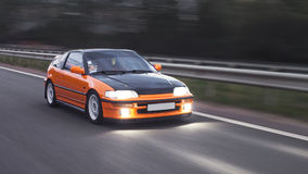 Orange sport car. Drive on the road Royalty Free Stock Photos
