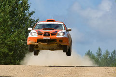 Orange sport car Subaru Impreza jumps at rally. ROSTOV, RUSSIA - JULY 27: Andrey Voroktov drives a Subaru Impreza  car during Rostov Velikiy Russian rally Royalty Free Stock Photos