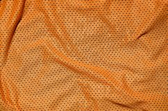 Orange sport clothing fabric texture background. Top view of orange cloth textile surface. Bright basketball shirt. Text Spac. E stock photos