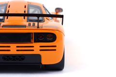 Orange sports car. Sports car isolated over white Royalty Free Stock Photos