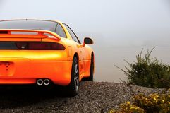 Orange sports car. Custom japanese orange sports car Royalty Free Stock Photography