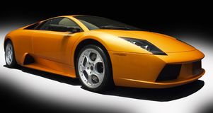 Orange sports car. On a black and white background Stock Photography
